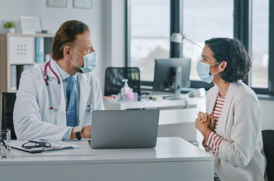Patient and doctor looking happy