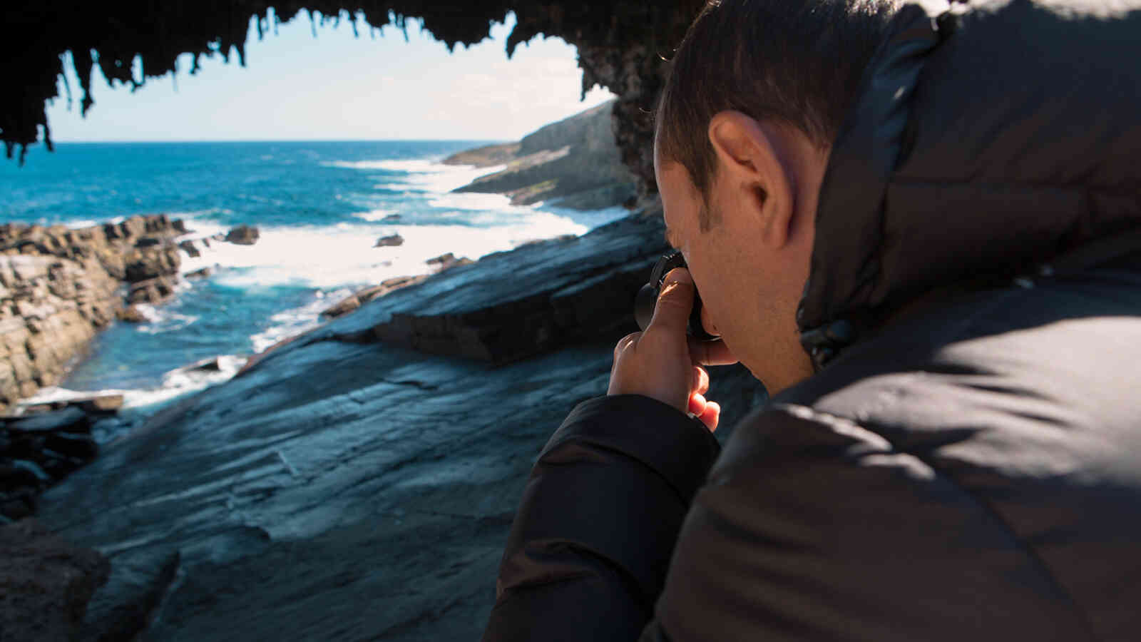 Man Taking Photos At Admirals Arch Kangaroo Island 1920X1200Px