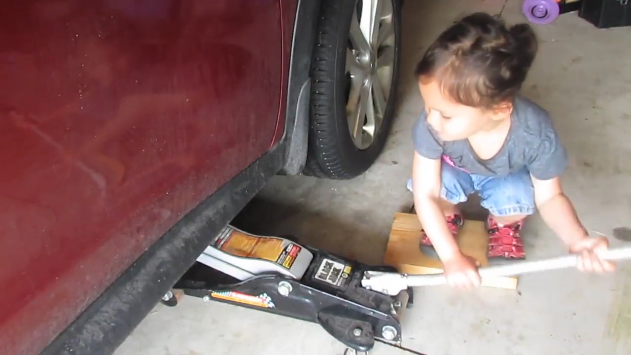 Little girl shows us how to do an car oil change