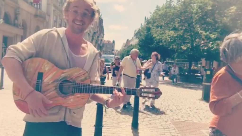 Watch Tom Felton busk in Prague's Old Town