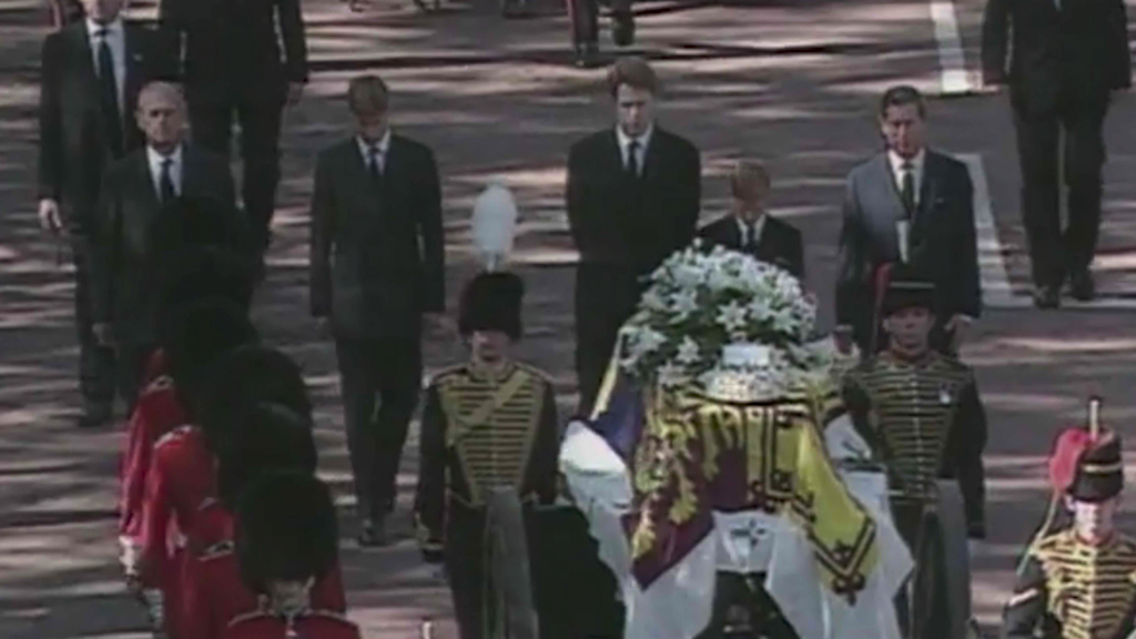 Princes Harry and William walk behind Princess Diana's coffin