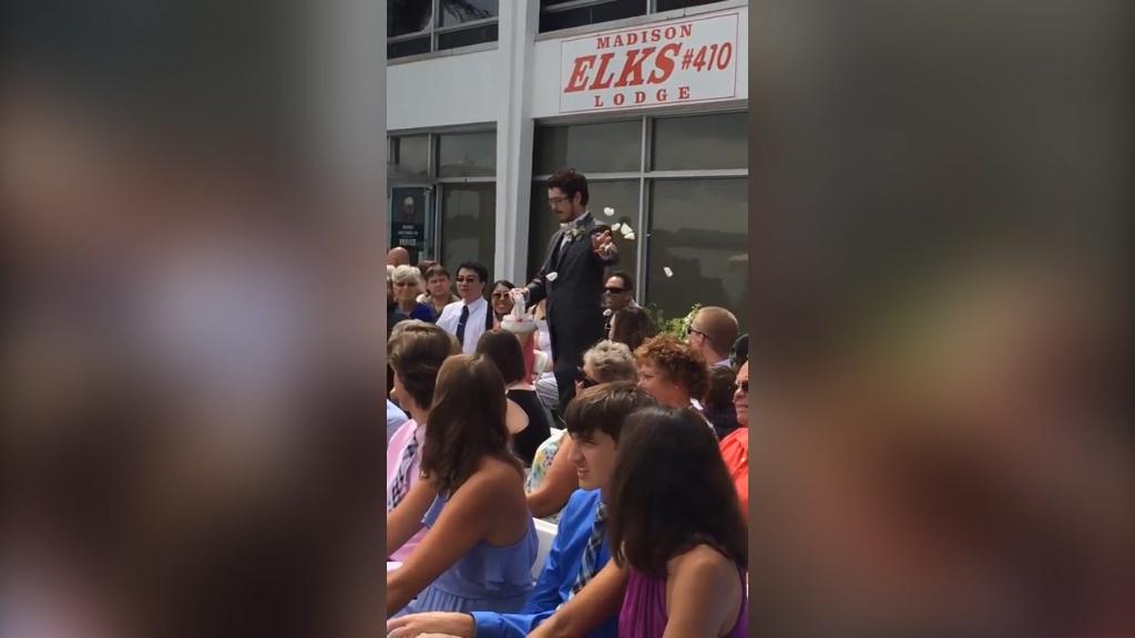 Grown man is flower girl at his best friend's wedding