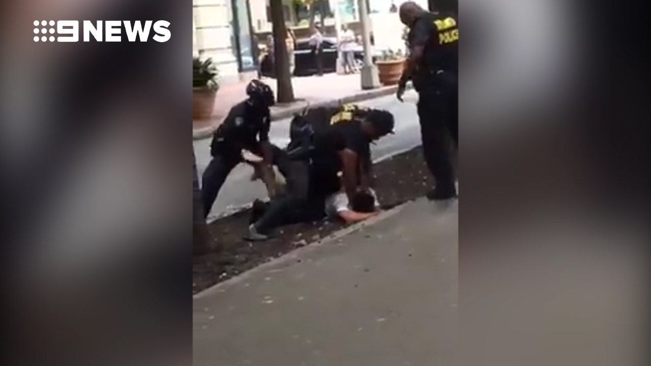 Cop punches man in the head