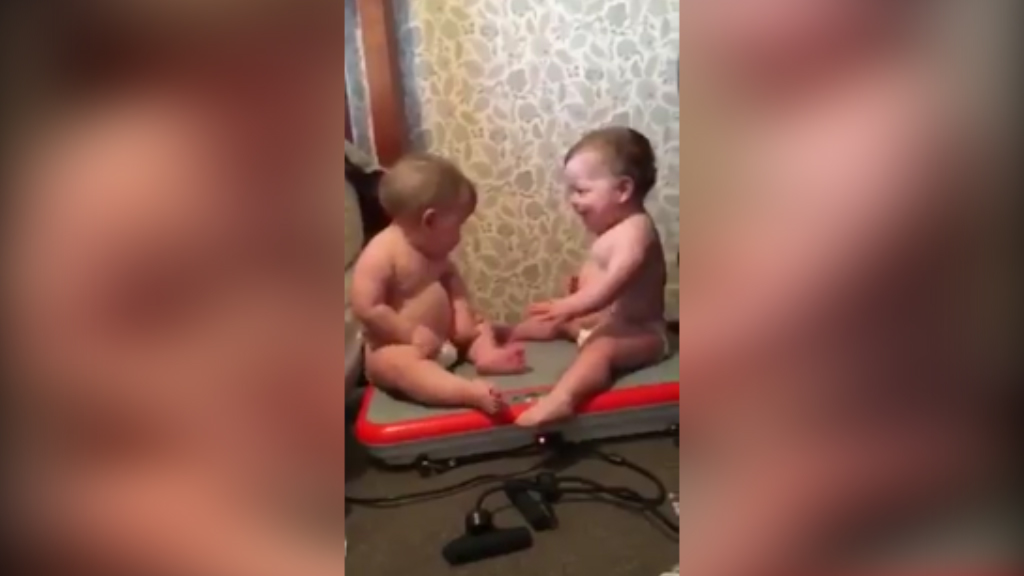 Shake, rattle and roll: two babies on a vibrational board.