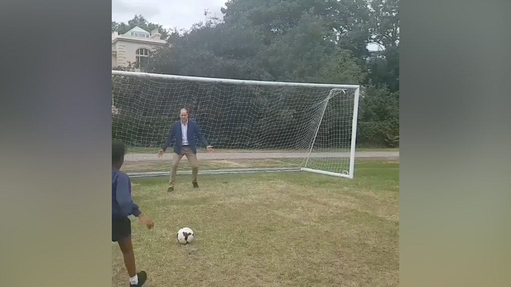 Prince William puts his goalkeeping skills to the test