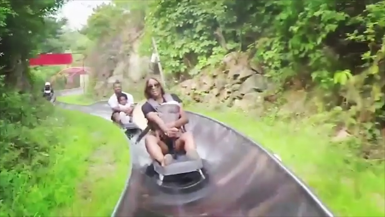 Ciara rides on a toboggan with her three-month-old child