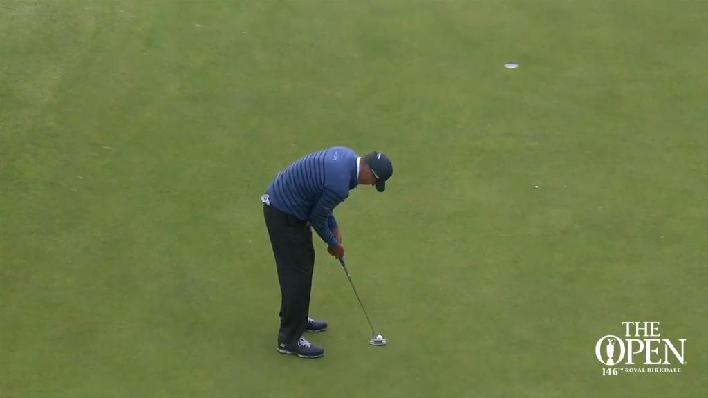 Matt Kuchar holes a putt at the British Open
