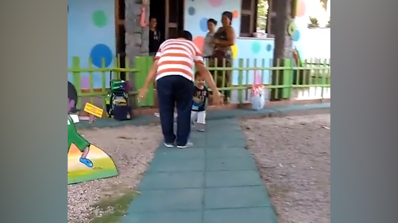 Kid runs past father and straight to mother