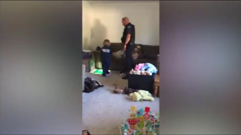 Officer helps little girl search for 'monsters' in the house