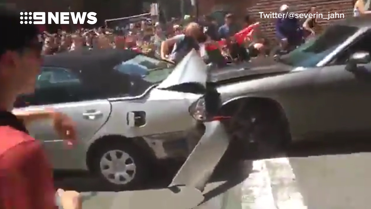 9RAW: Car ploughs through crowd of protesters