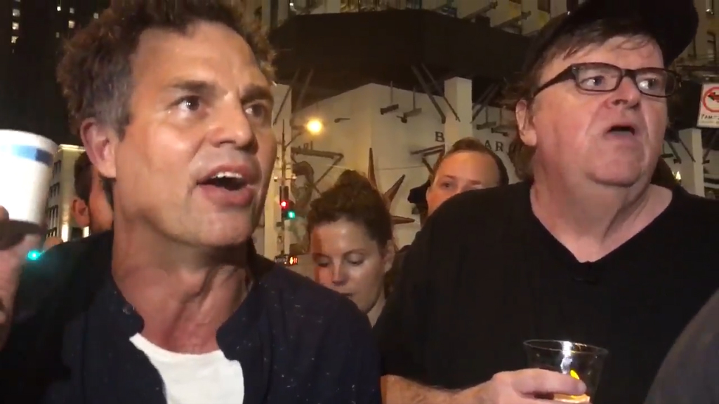 Mark Ruffalo and Olivia Wilde join Michael Moore's anti-Trump rally in New York