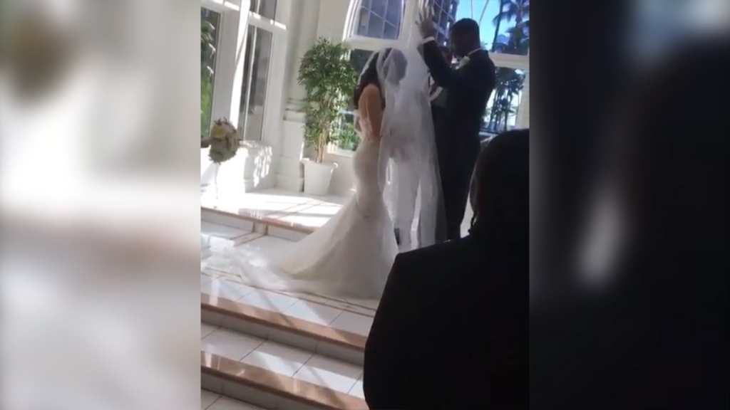 Groom can't remove bride's veil