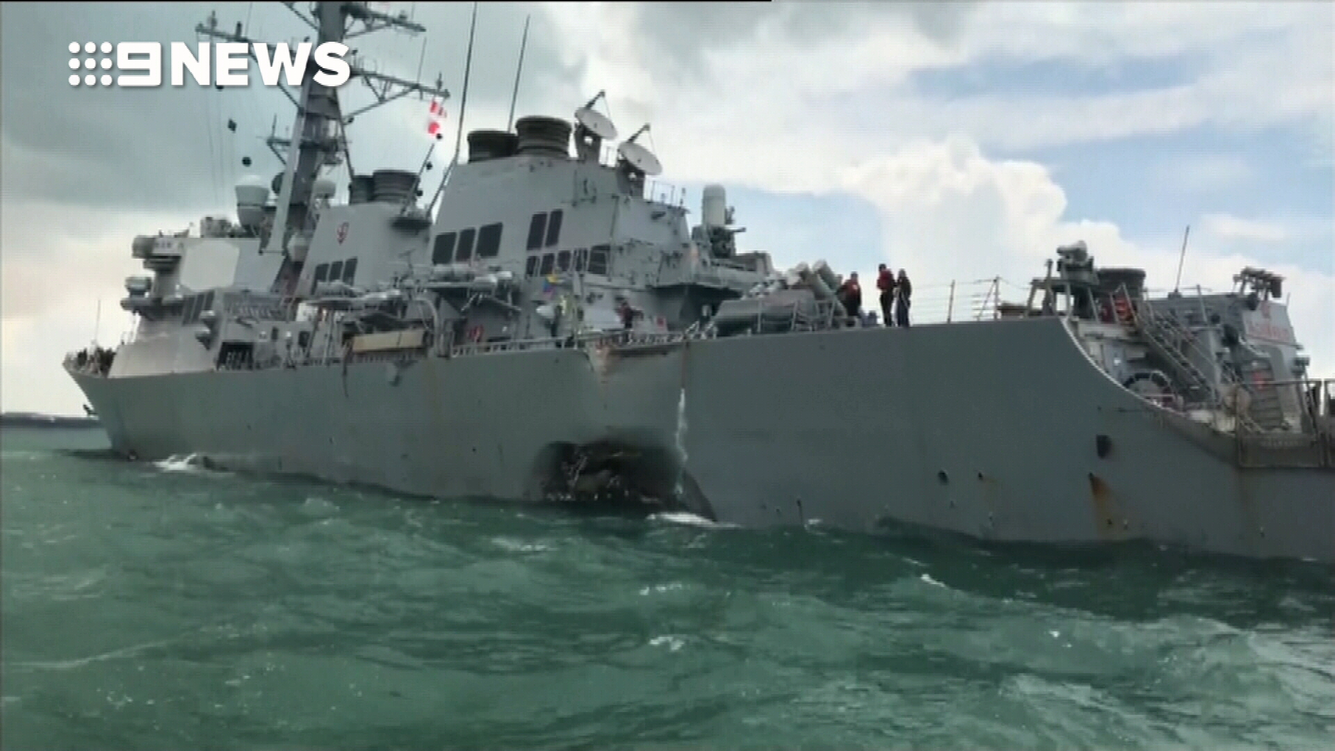 US destroyer collides with merchant ship