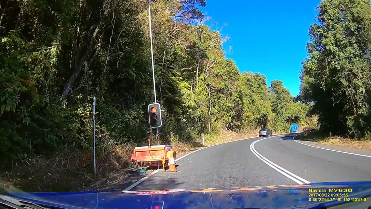 Driver gets a dose of karma after driving through road works
