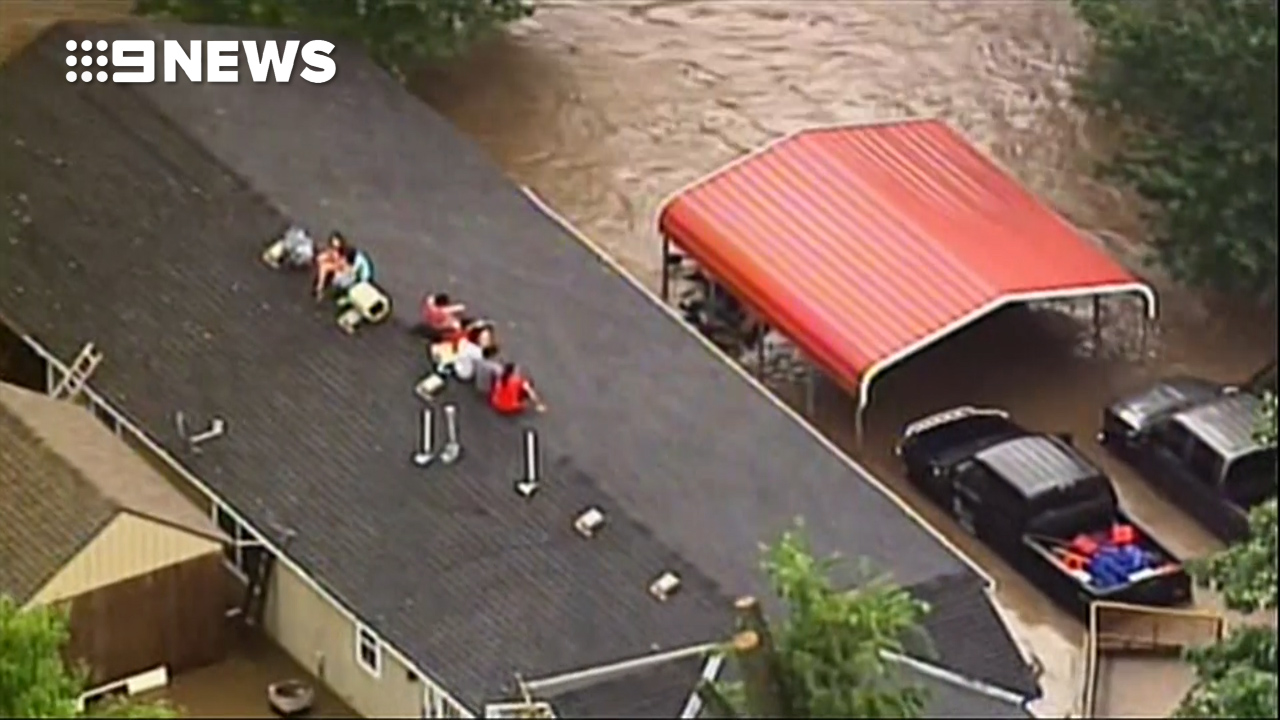 Kansas City family forced onto house roof to avoid floodwaters