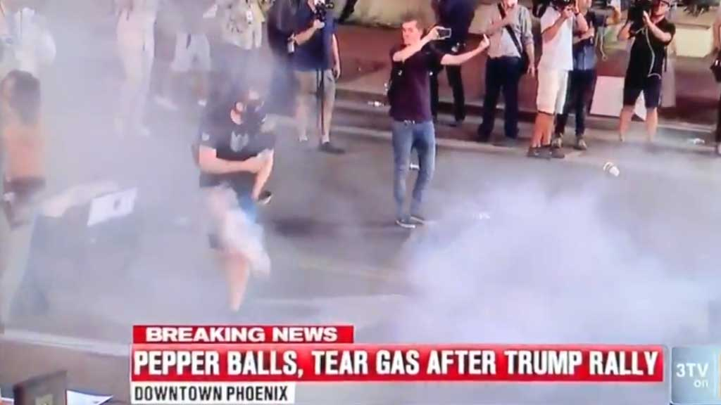 Protestor shot with pepper bullets by riot police