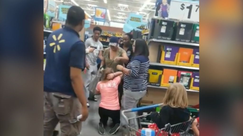 9RAW: Mum pulls gun on rival shopper during back-to-school sale