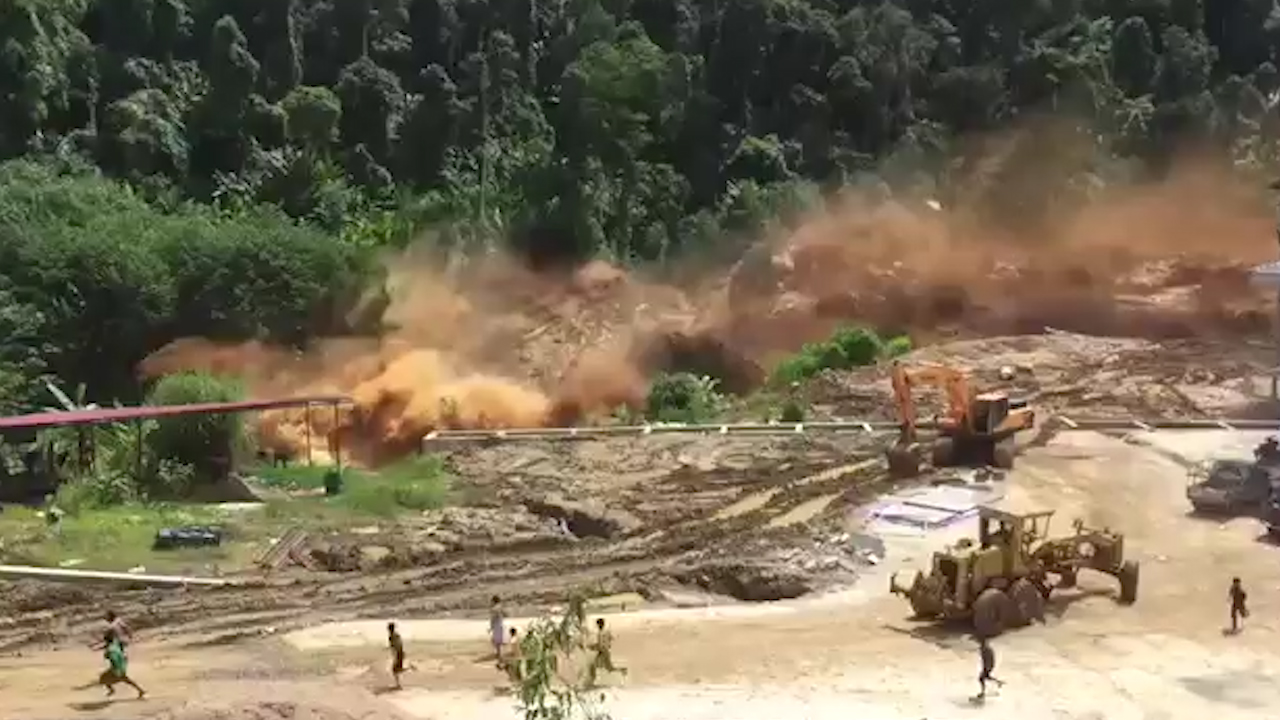Laos workers run from burst dam torrent