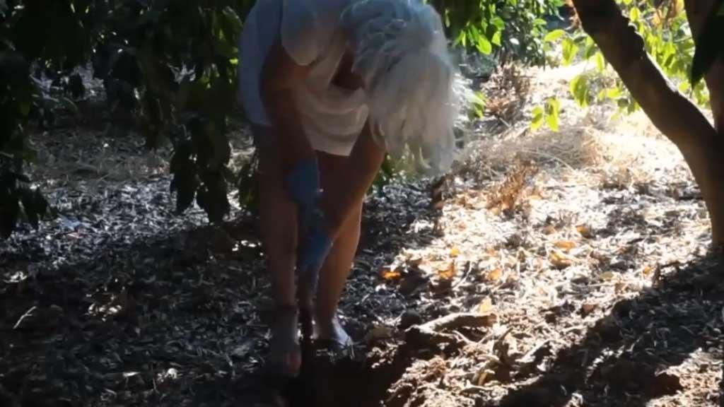 Woman breaks down in tears after burying her own heart