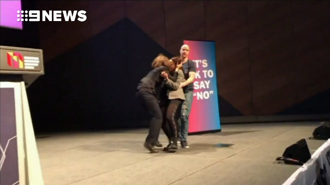 Same-sex marriage supporters stage kiss protest
