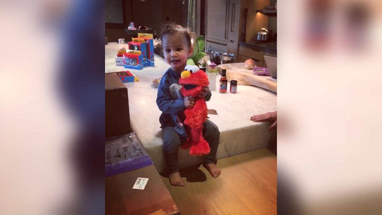 Chrissy Teigen gives her daughter Elmo toy