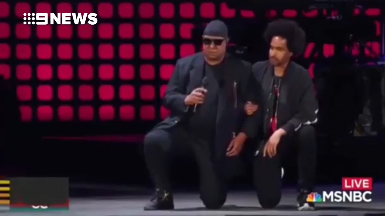 Stevie Wonder 'takes a knee' on stage