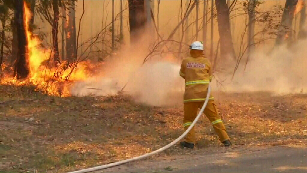Bushfires burning close to homes