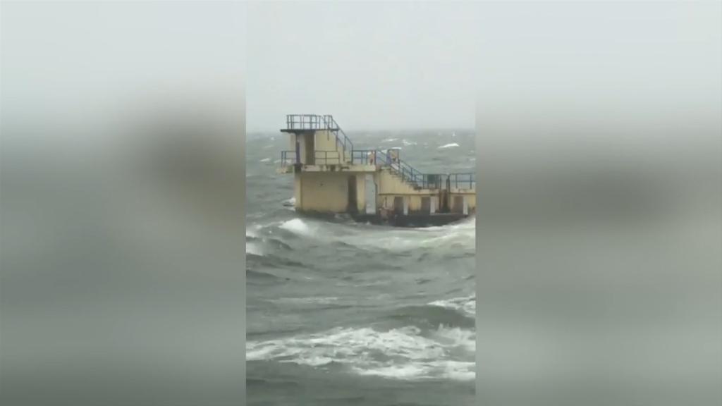Men filmed swimming in ocean during Hurricane Ophelia