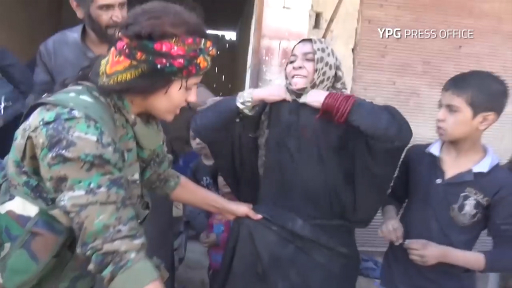 Woman tears off burqa after ISIS liberation
