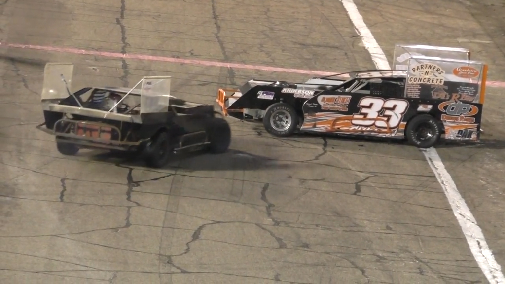 Racer drives over tail-clipping opponent, sparks fight