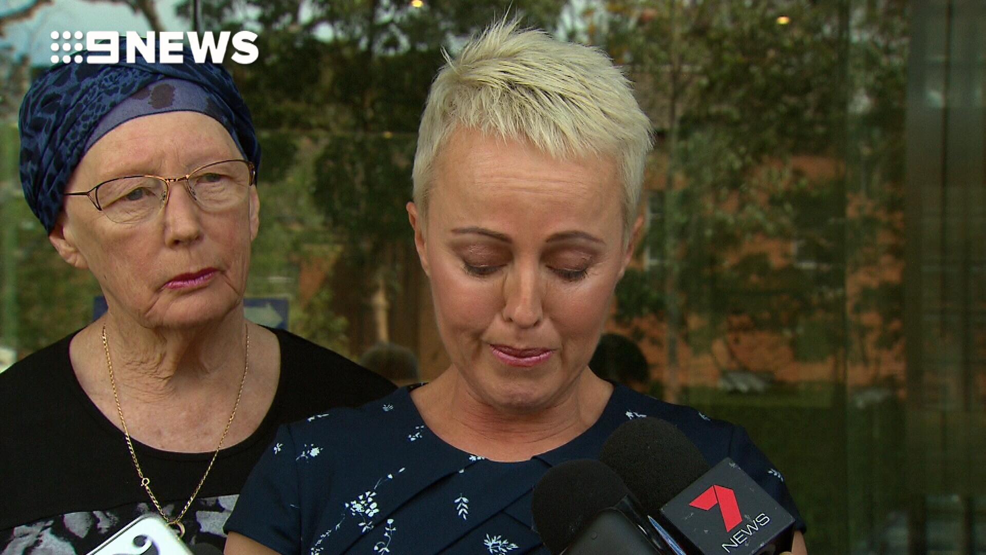 Ashley Bryant's widow breaks down outside court