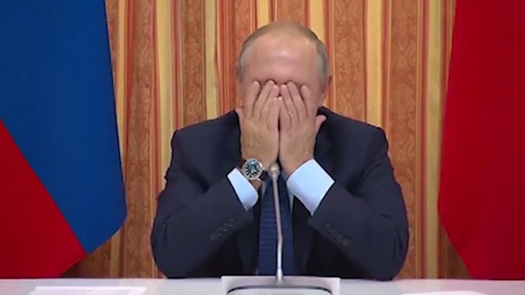 Putin giggles at minister's proposal