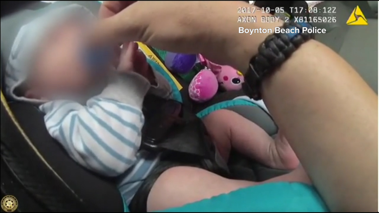 Police comfort babies after mums overdose on heroin