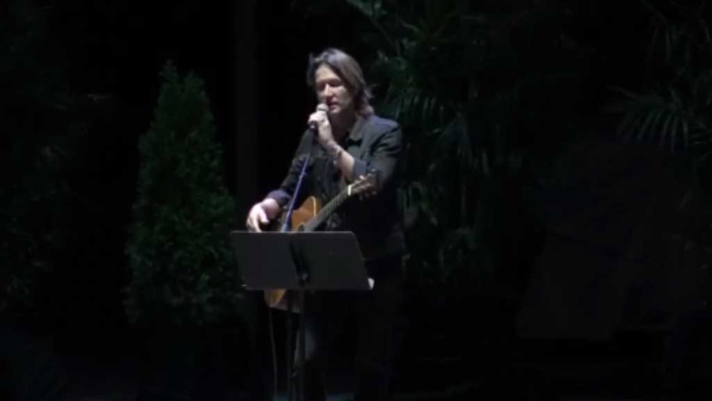 Keith Urban performs at a candlelight vigil
