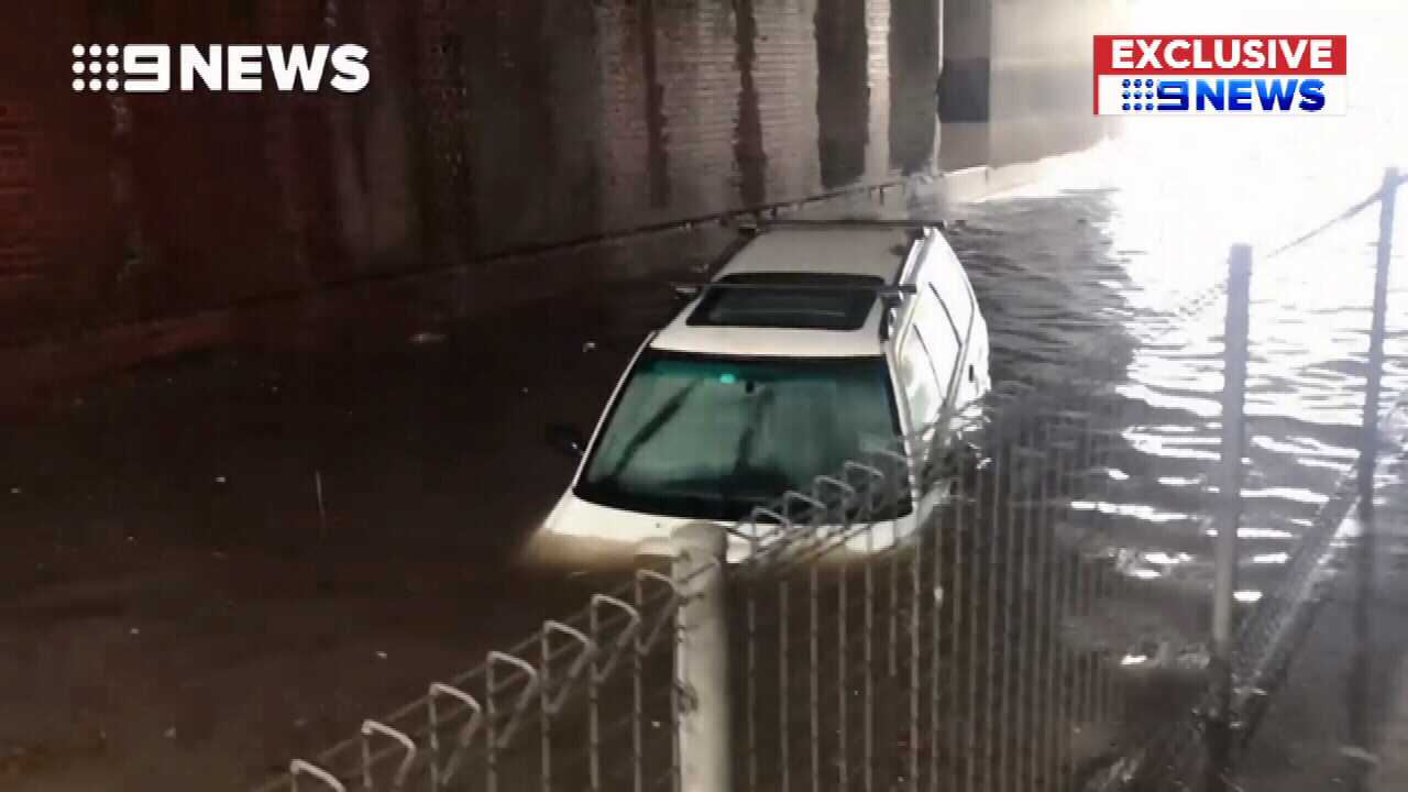 Moment car drives straight into floodwaters