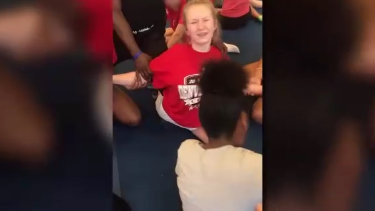 Cheerleaders forced to do the splits