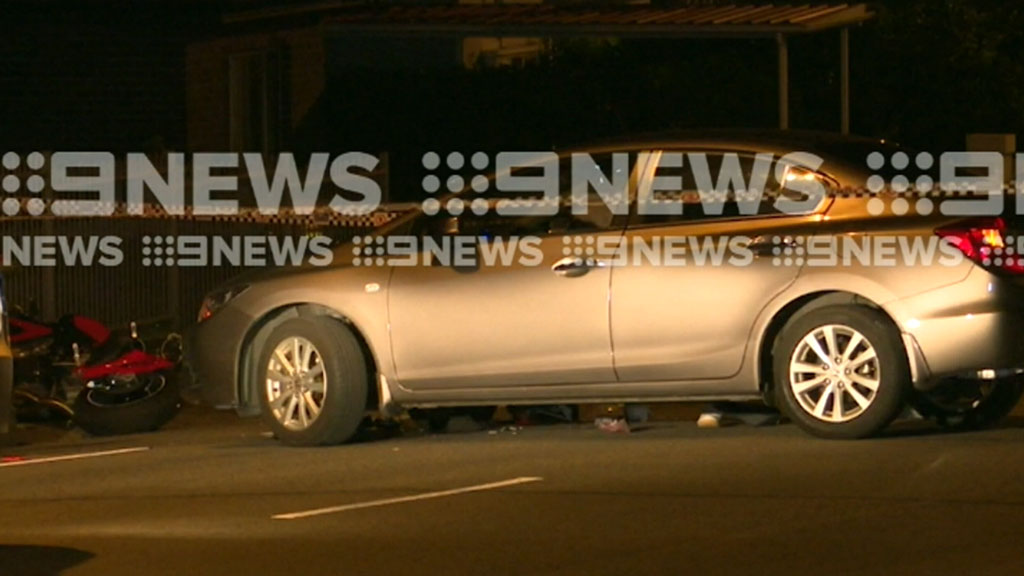 Man dies after motorcycle collides with car