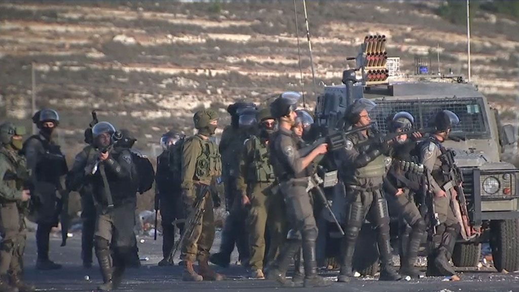Protesters clash with Israeli soldiers on the West Bank