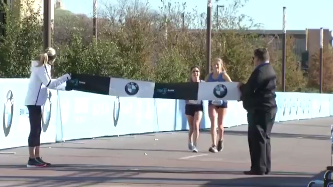 High school student helps fallen runner win marathon
