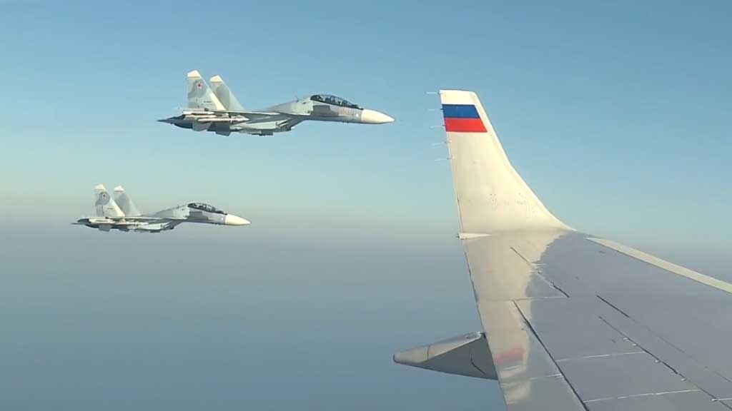 Military jets escort Putin on surprise visit to Air Base