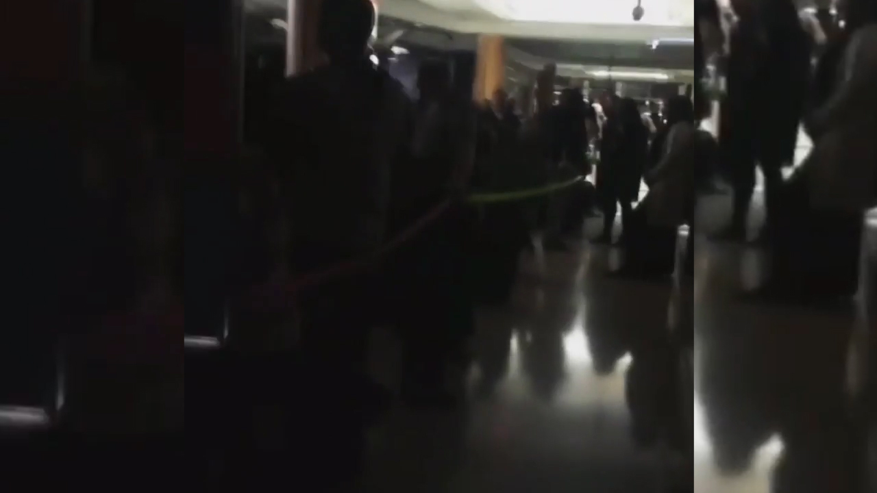 Passengers wait in the the dark at Atlanta airport