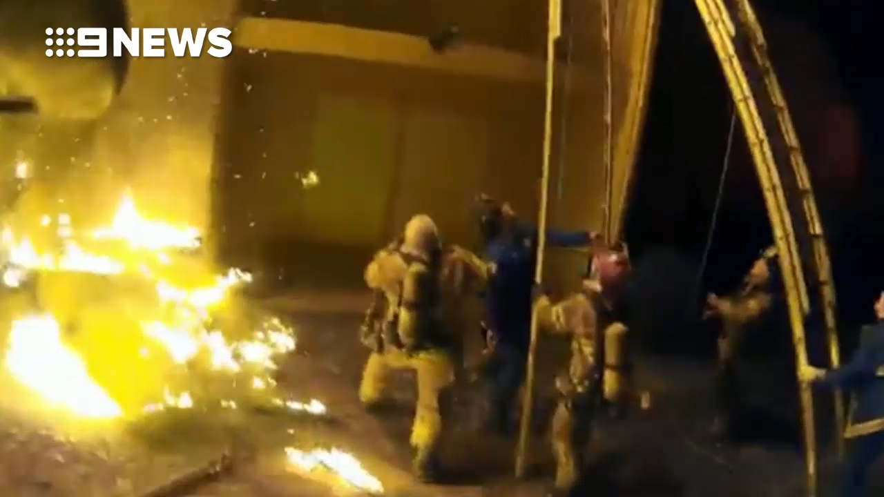 Child dropped by parent escaping blaze