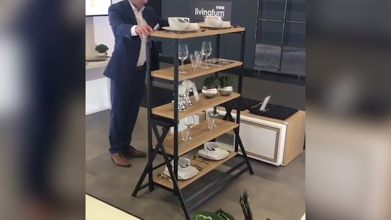 The Dining Table That Turns Into A Shelf In Two Seconds Flat