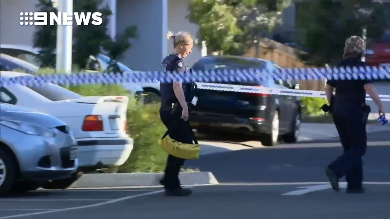 Heavily armed police swarm Point Cook