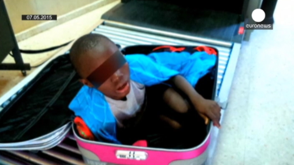 Father of boy in suitcase walks free