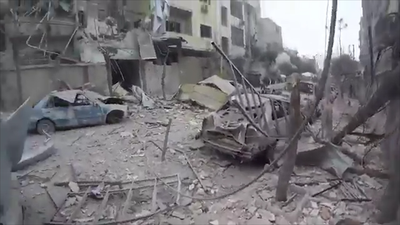 Man evacuated through bomb ravaged Ghouta