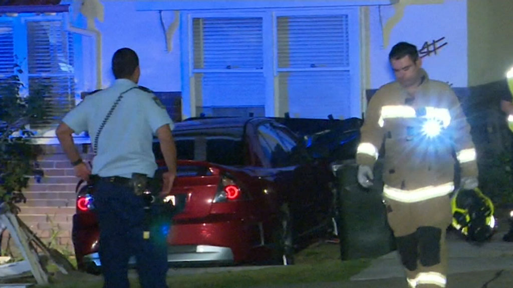 Car plunges into house in NSW