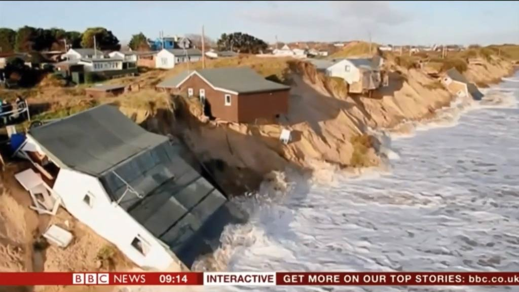 Wild UK weather washes clifftop houses away