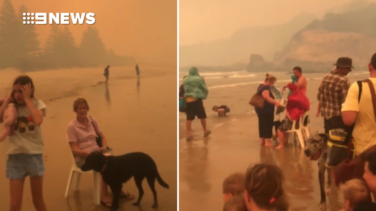 Residents take shelter from fires on Tathra Beach