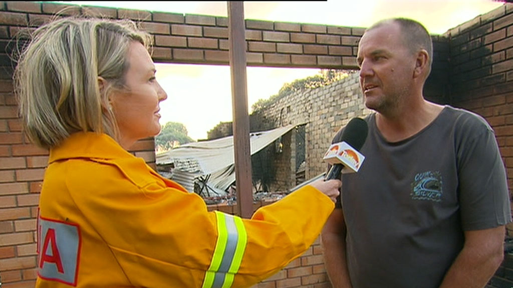 Tathra IGA owner returns to destroyed home